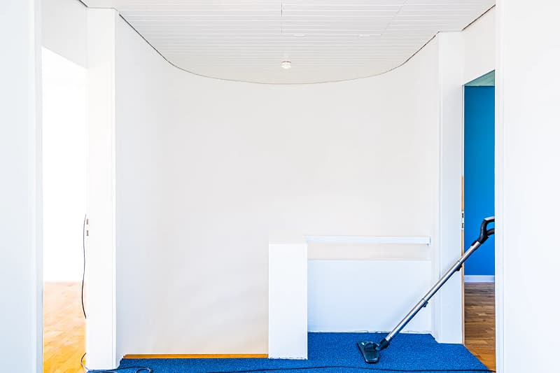 Cleaning Room with Vacuum Cleaner